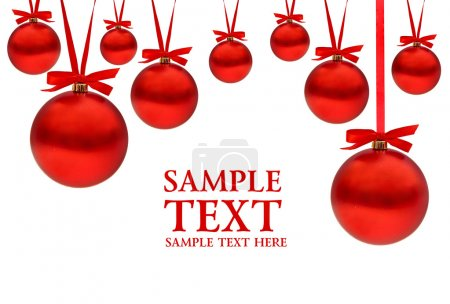 Christmas card with red balls and ribbons with space for your text