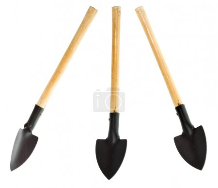Spade shovels with a wood handle , isolated over a...