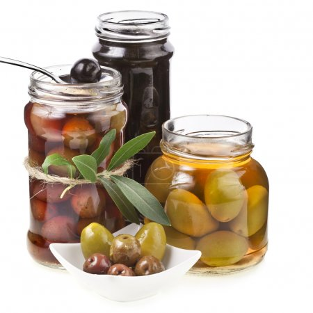 Photo for Assorted marinated olives with spices in glass jar on a white background - Royalty Free Image