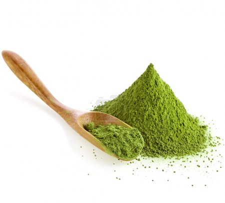 Powdered green tea with bamboo spoon, isolated on ...