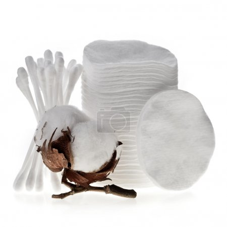 Cotton swabs, pads, sticks and cotton bolls isolated on white