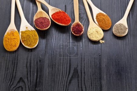 Photo for Powder spices on wooden spoons - Royalty Free Image