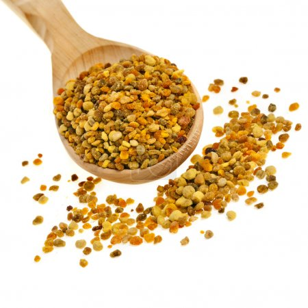 Bee pollen in the spoon on white