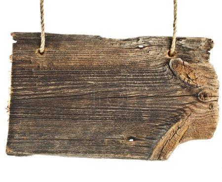 Photo pour Signez un pointeur vers l'ancienne planche de bois isolée sur fond blanc - image libre de droit