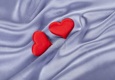 Beautiful Silk Background with red hearts