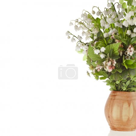 Photo for Bouquet of lilies-of-the-valle y with bloom blueberries cowberries on wooden vase - Royalty Free Image