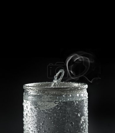 Adrink can with water droplets on black background