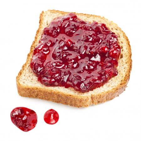Slice of bread with red jam isolated on white background