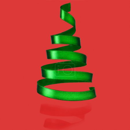 Christmas tree from green ribbon tape on red background