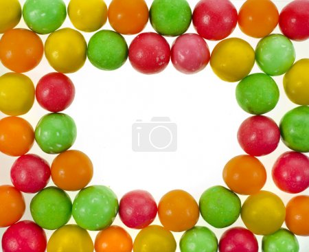 Frame of colored background of assorted candies balls