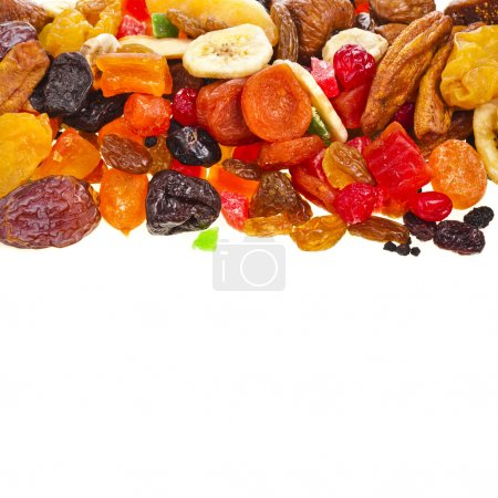 Border of mix dried fruits on white background