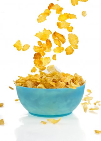 Photo for Flying to the bowl corn flakes isolated on white background - Royalty Free Image