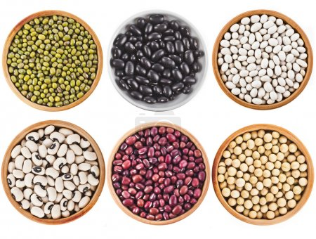 Collection set of Various dried kidney legumes haricot beans in wooden bowl