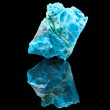 Chrysocolla mineral stone, with reflection on blac...