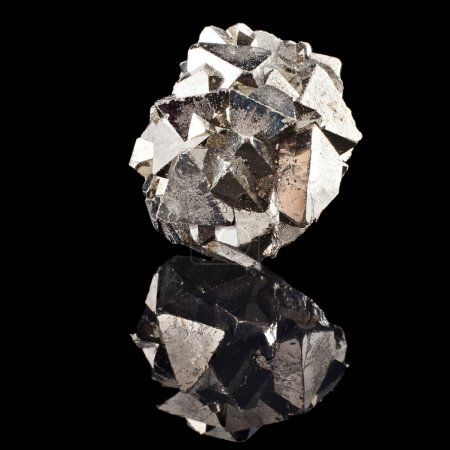 Pyrite with reflection on black surface background...