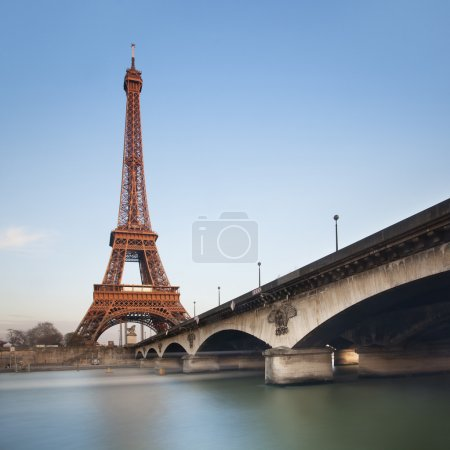 Eiffel tower over blue sky at sunset, Paris. France