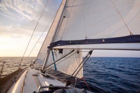 Sailing on yacht at sunset