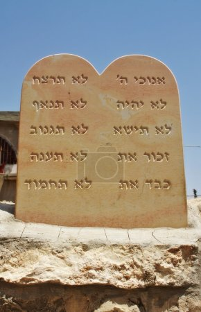 The ten commandments carved in a stone