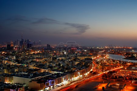 A skyline panorama of Dubai at dusk showing Deira and the Creek