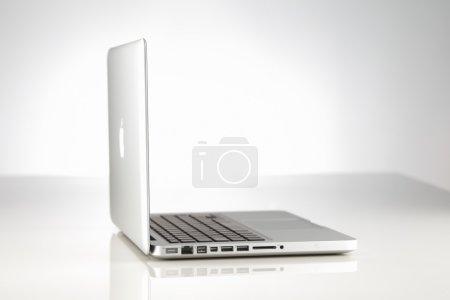 A beautifully lit Apple MacBook Pro laptop