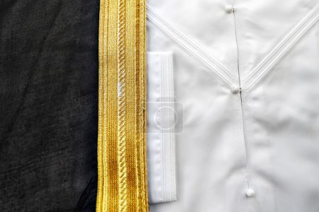 A bisht is a traditional Arabic men piece of clothes