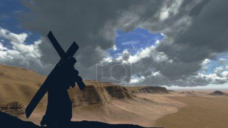 Photo pour La figure du Christ portant la croix jusqu'au Calvaire le Vendredi saint. Le ciel est sombre et orageux . - image libre de droit