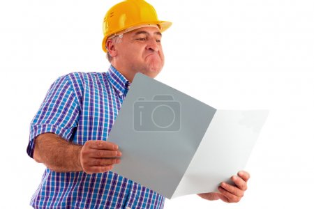 Expressive engineer looking at plans