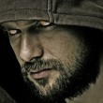 Close-up portrait of threatening man with beard we...