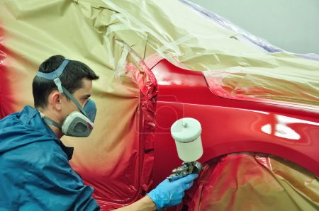 Photo for Worker painting a car - Royalty Free Image