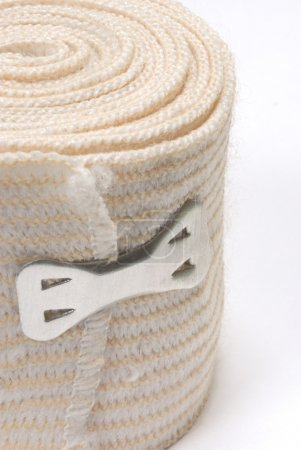 elastic tensor bandage with clip holding it together
