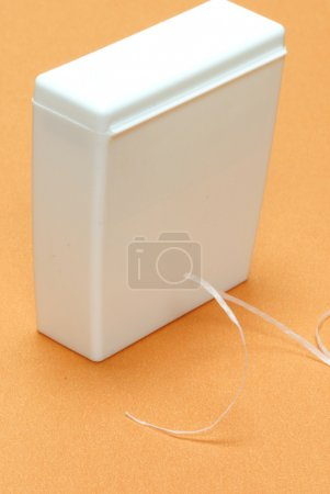 Waxed dental floss in an unmarked container