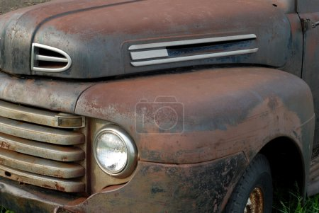 Close up details on a rusted out vintage pick up truck