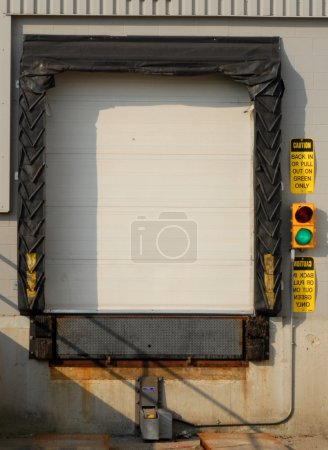 industrial transport truck loading dock with green light on