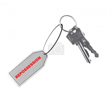 car or house keys with fob or tag saying repossession