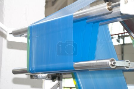 Photo for Production of blue household garbage plastic bags - Royalty Free Image