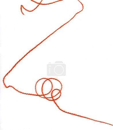 Red twirled thread