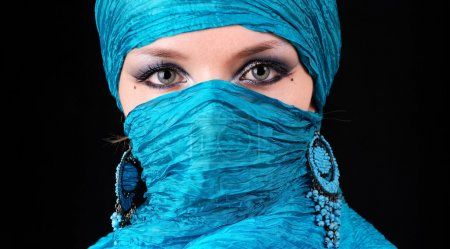 Blue woman's eyes with east make-up