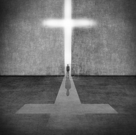 Photo pour Silhouette d'une personne avant un symbole de la foi - image libre de droit