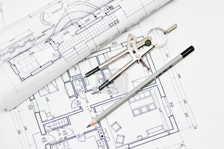 heap of architectural design and project blueprints drawings of