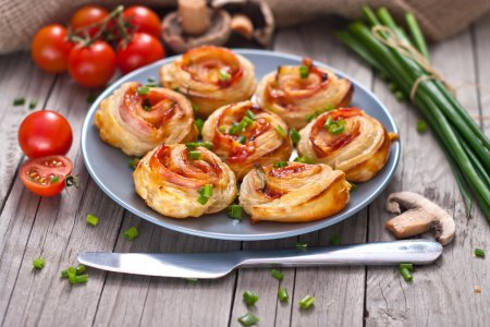 Photo for Puff pastry rolls with ham and chese. Baked snacks. - Royalty Free Image