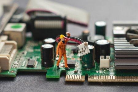 Engineer repairing circuit board. Computer repair concept.