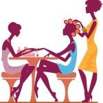 Women in a beauty salon getting a manicure...