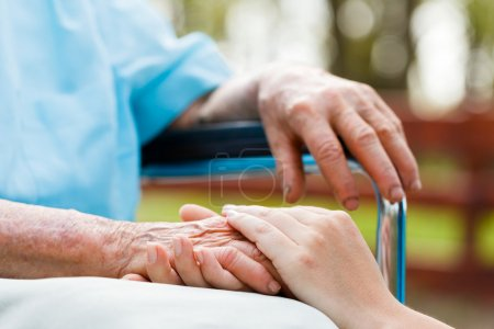 Photo for Caring woman hands over elderly hands being concept of trust and reliability - Royalty Free Image