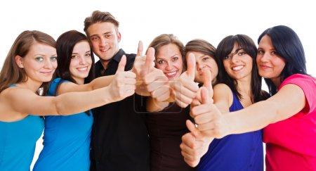 Photo pour Membres de l'équipe montrant thumbs up pour leur grande réussite. - image libre de droit