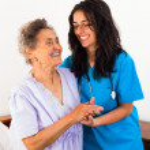 Постер, плакат: Nurses caring about elderly patient