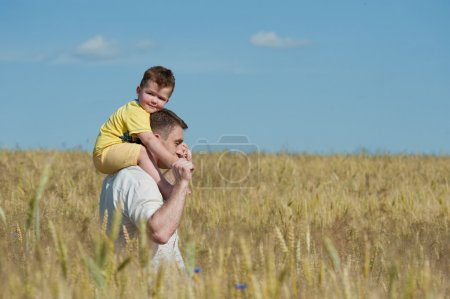 Dad and son going in the field