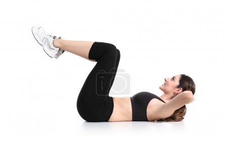 Beautiful woman doing abdominal crunches