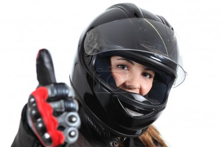 Happy biker woman with a road helmet and thumb up