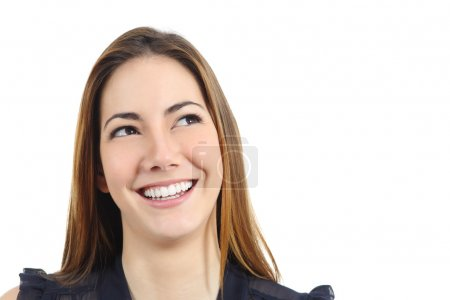 Portrait of a happy woman with perfect white smile looking sideways
