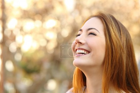 Photo for Portrait of a woman laughing with a perfect teeth on a warmth background - Royalty Free Image